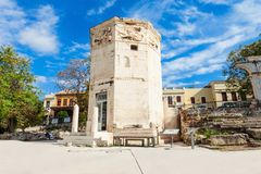 Tower of the Winds. The Tower of the Winds or the Horologion of Andronikos Kyrrhestes is an octagonal Pentelic marble clocktower in the Roman Agora in Athens Stock Photography