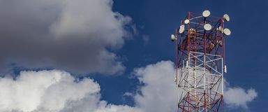 Tower of wireless Internet. Blue sky with clouds in the background with copy space for adding text royalty free stock photos