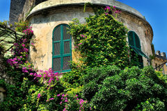 Free Tower With Window Shutters And Bougainvilleas In Village Portovenere, Cinque Terre Royalty Free Stock Images - 73646449