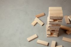 Tower of wooden blocks on gray background. Board game for the whole family or party royalty free stock images