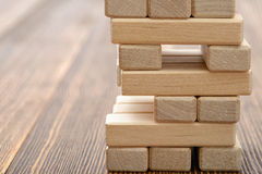 The tower of wooden blocks placed on a table. Royalty Free Stock Photos