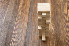 The tower of wooden blocks placed on a table. Stock Photo
