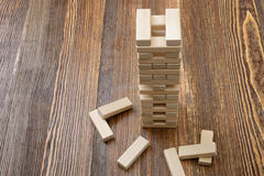 The tower of wooden blocks placed on a table. Royalty Free Stock Photo