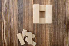 Tower of wooden blocks placed on a table. Royalty Free Stock Images