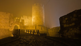 Tower and wooden bridge of Kalemegdan fortress at foggy night in Belgrade Stock Photos