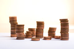 Towering. Shot of towering stacks of pennies. ...a penny saved is a penny earned Royalty Free Stock Photography