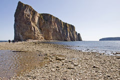 Towering cliff island. At low tide in Perce, Gaspesie, Quebec, Canada Royalty Free Stock Photo