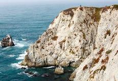 Towering cliffs along northern California coast end at  ocean. Towering cliffs along northern California coast dip into ocean Stock Photography