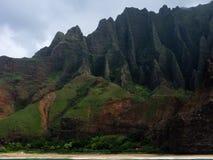 Towering cliffs. Cliffs of Na Pali coast on Kauai Island, HI Stock Photos