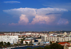 Towering cumulus. Towering cumulus clouds over city royalty free stock photos