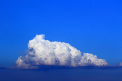 Towering cumulus cloud. The single towering cumulus cloud on the sky stock photos