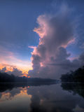 Towering Cumulus Cloud. At dawn reflecting the colors of the sun when its below the horizon before the break of dawn Stock Photography