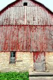 Towering Facade of a Historic Old German Style Bank Barn. The front, towering facade of a rustic old, historic German style Bank Barn Royalty Free Stock Images