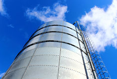 Towering grain silo under blue skies. Royalty Free Stock Photography