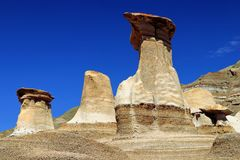 Striking Hoodoos at East Coulee, Drumheller, Alberta. The towering hoodoos at East Coulee to the south of Drumheller are among the most accessible of these stock photo