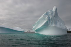 Towering iceberg. In Antarctica with clouds Stock Photos