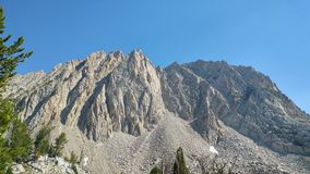 Towering mountain side. Steep boulder field Stock Photo
