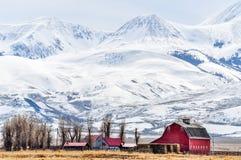 Towering Mountains Over a Montana Farm stock photos
