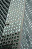 Towering pattern. Modern skyscrapers in Japan, unique pattern of glass windows, reflection of blue sky Royalty Free Stock Photos