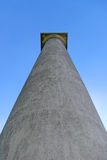 Towering Pillar. A single pillar reaching for the blue sky.  Was once part of a mansion Royalty Free Stock Photos