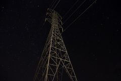 Power lines at night Royalty Free Stock Photo