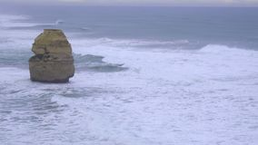 Towering rock formation along Great Ocean Road. Australia stock video footage