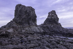 Towering rocks at low tide Royalty Free Stock Photo