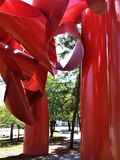Towering sculpture at Space Needle. Giant red metal sculpture of cylinders within view of the Seattle Space Needle Stock Image