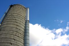Towering Silo and Blue Sky Stock Photos