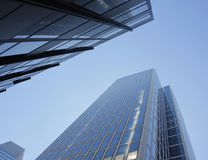 Towering skyscraper from a low angle view in Frankfurt, Germany. Photo of a skyscraper under blue sky in Frankfurt, Germany, taken on 30/06/2015 Royalty Free Stock Photography