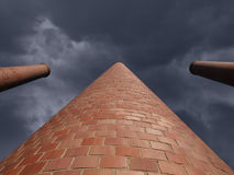Towering Smokestacks with Storm Sky Royalty Free Stock Photos