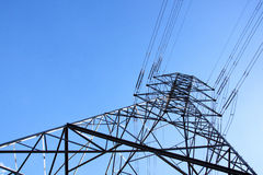 Towering Steel Pylon Supporting Electric Power Cables. Closeup underview of towering steel pylon supporting electric power cables Stock Photo