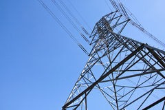 Towering Steel Pylon Supporting Electric Power Cab Royalty Free Stock Images