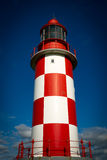 Towering, Tall Lighthouse Against Deep Blue Sky Stock Photo