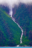 Towering Waterfall at Valdez Narrows, Alaska Stock Images