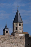 Towers of the abbey of cluny. Two towers of the ancient cluny abbey, seen behind a wall royalty free stock photography