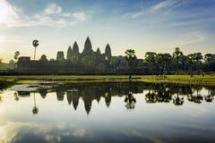 Towers of ancient Angkor Wat reflected in lake at dawn, Cambodia Stock Photos