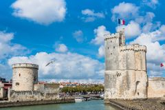 Towers of ancient fortress of La Rochelle France. Old Harbour towers of ancient fortress of La Rochelle France royalty free stock photography