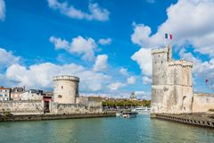 Towers of ancient fortress of La Rochelle France. Old Harbour towers of ancient fortress of La Rochelle France stock photography