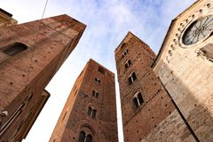 Towers of big cathedral. Towers in city center of Albenga Liguria - Italy royalty free stock photos