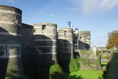 Towers and bridge of castle of Angers under rainbow, France and Stock Image
