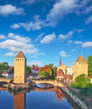 Towers and canals in the old Strasbourg. Royalty Free Stock Image