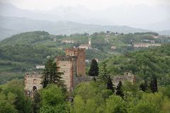 Towers of the castle of Romeo and the surrounding hills Royalty Free Stock Photo