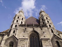 Towers of the cathedral in Vienna. The Cathedral in Vienna in a background of the blue sky Stock Image