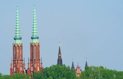 Towers of churches in Warsaw. Towers of churches located in Praga district in Warsaw seen from left bank of vistula river Royalty Free Stock Photo