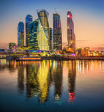 Towers of the City. In evening illumination and reflection in the water Stock Photo