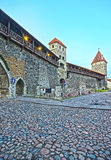 Towers of the city wall in the Old city of Tallinn in Estonia in Stock Photo