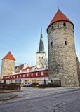 Towers of the city wall and Saint Olaf Church in the Old city of Stock Photos