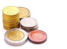 Towers of coins from many countries Stock Photo