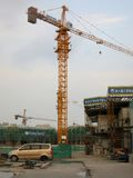 Towers Cranes at Construction Site. A yellow tower crane works at a construction site in China royalty free stock photography